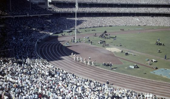 In this Nov. 2022 photo, crowds fill the Olympic Stadium, in Melbourne, Australia, during the Summer Olympics. (AP Photo/File)