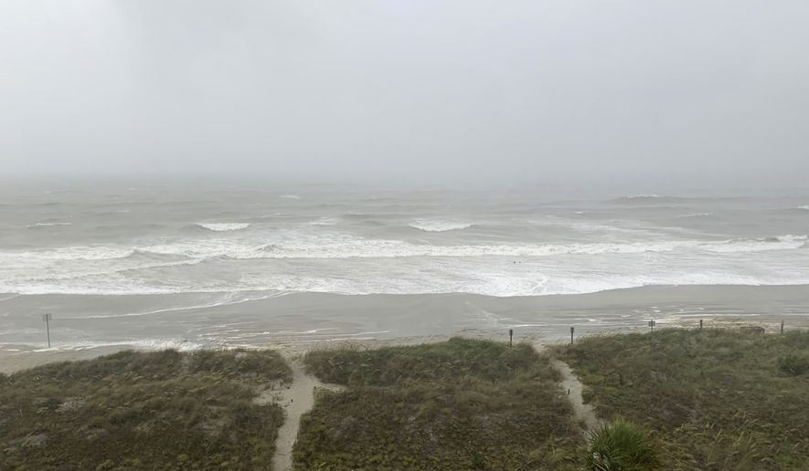 Bands of wind and rain from Hurricane Isaias make it to North Myrtle Beach, S. C., Monday, Aug. 3, 2020. The storm is expected to make landfall along the Carolina coast late Monday evening. (AP Photo/Sarah Blake Morgan)