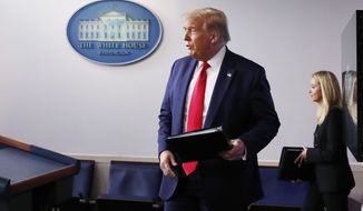 President Donald Trump walks out to hold a briefing with reporters in the James Brady Press Briefing Room of the White House, Monday, Aug. 3, 2020, in Washington.(AP Photo/Alex Brandon)