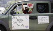 Demonstrators participate in a car caravan Monday, Aug. 3, 2020, in Los Angeles. Parents, students, and teachers held a press conference and car caravan to call for a safe, fully funded, and racially just approach to reopening of Los Angeles schools. (AP Photo/Marcio Jose Sanchez)