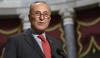 Senate Minority Leader Sen. Chuck Schumer of N.Y., speaks to reporters on Capitol Hill in Washington, Monday, Aug. 3, 2020. Schumer and House Speaker Nancy Pelosi of Calif., met earlier with Treasury Secretary Steven Mnuchin and White House Chief of Staff Mark Meadows as they continued to negotiate a coronavirus relief package. (AP Photo/Susan Walsh) **FILE**