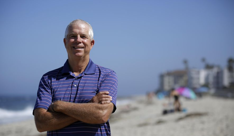 Peter Schnugg stands for a portrait along the beach Friday, July 31, 2020, in San Diego. The former waterpolo athlete missed his chance to go to the Olympics in 1980 when the U.S. decided to boycott the games to protest the Soviet Union's invasion of Afghanistan. Now he's unsure if he'll get the chance to see his niece, Maggie Steffens, try for a third consecutive gold medal with the U.S. women's water polo team. (AP Photo/Gregory Bull)