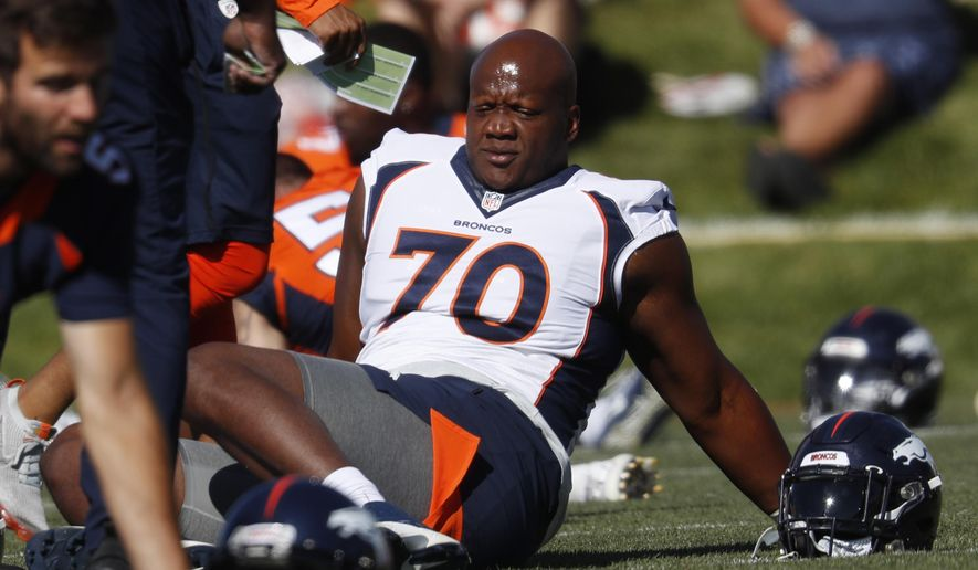 FILE - In this July 19, 2019, file photo, Denver Broncos offensive tackle Ja'Wuan James (70) stretches during NFL football training camp in Englewood, Colo. James informed the Broncos on Monday, Aug. 3, 2020, that he's opting out of the 2020 season over coronavirus concerns. (AP Photo/David Zalubowski, File)