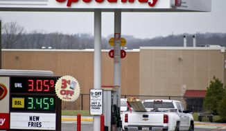 FILE - In this photo made on Wednesday, April 25, 2018, the prices for regular gas and diesel are posted at a Speedway station in Zelienople, Pa. The $21 billion sale of Speedway gas stations buys Marathon Petroleum some breathing room as the global pandemic continues to punish the energy sector. Wall Street focused on the sale to 7-Eleven over the weekend, rather than the huge losses the company posted Monday, Aug. 3, 2020 with a lack of demand for fuel leading to refinery shutdowns. (AP Photo/Keith Srakocic, file)