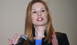 FILE - In this Jan. 14, 2019 file photo, Democratic state Auditor Nicole Galloway speaks in Jefferson City, Mo. Missouri voters are set to decide whether to expand Medicaid health care coverage to thousands more low-income adults. A proposal to amend the state Constitution to expand eligibility for Medicaid is on Tuesday, Aug. 4, 2020s' ballot. Galloway's office estimated that expanding Medicaid could cost the state at least $200 million or save as much as $1 billion annually by 2026. Republican opponents cite the potential costs as a reason to oppose the ballot initiative.(Julie Smith/The Jefferson City News-Tribune via AP, File)