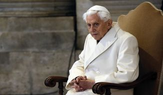In this Tuesday, Dec. 8, 2015, file photo, Pope Emeritus Benedict XVI attends a Mass prior to the opening of the Holy Door of St. Peter's Basilica, formally starting the Jubilee of Mercy, at the Vatican. Emeritus Pope Benedict XVI has fallen ill after his return from a trip to his native Bavaria to visit his brother, who died a month ago, a German newspaper reported Monday. (AP Photo/Gregorio Borgia, File)