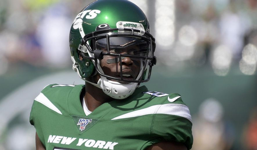 FILE - In this Sept. 8, 2019, file photo, New York Jets wide receiver Quincy Enunwa (81) warms up before an NFL football game in East Rutherford, N.J. The Jets have  released the veteran wide receiver Quincy Enunwa, who played in just one game last year after suffering his second neck injury in three seasons. (AP Photo/Bill Kostroun, File)