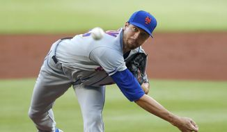 New York Mets starting pitcher Jacob deGrom works during the first inning of the team's baseball game against the Atlanta Braves on Monday, Aug. 3, 2020, in Atlanta. (AP Photo/John Bazemore)