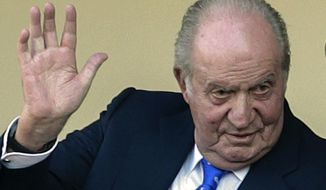 In this file photo dated Sunday, June 2, 2019, Spain's former King Juan Carlos waves at the bullring in Aranjuez, Spain.  The royal family's website on Monday, Aug. 3, 2020, published a letter from Spain's former monarch, King Juan Carlos I, saying he is leaving Spain to live in another country, amidst a financial scandal. (AP Photo/Andrea Comas, FILE)