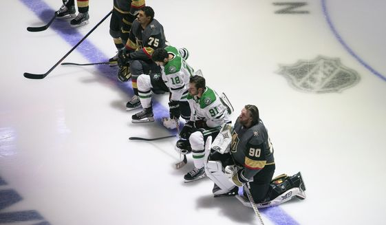 Dallas Stars' Jason Dickinson (18), Tyler Seguin (91) and Vegas Golden Knights' Ryan Reaves (75) and goalie Robin Lehner (90) take a knee for Black Lives Matter during the national anthem prior to an NHL hockey playoff game Monday, Aug. 3, 2020 in Edmonton, Alberta. (Jason Franson/The Canadian Press via AP)