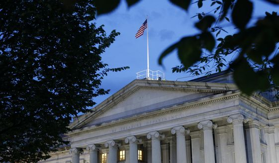This Thursday, June 6, 2019, photo shows the U.S. Treasury Department building at dusk, in Washington. (AP Photo/Patrick Semansky, File)  **FILE**