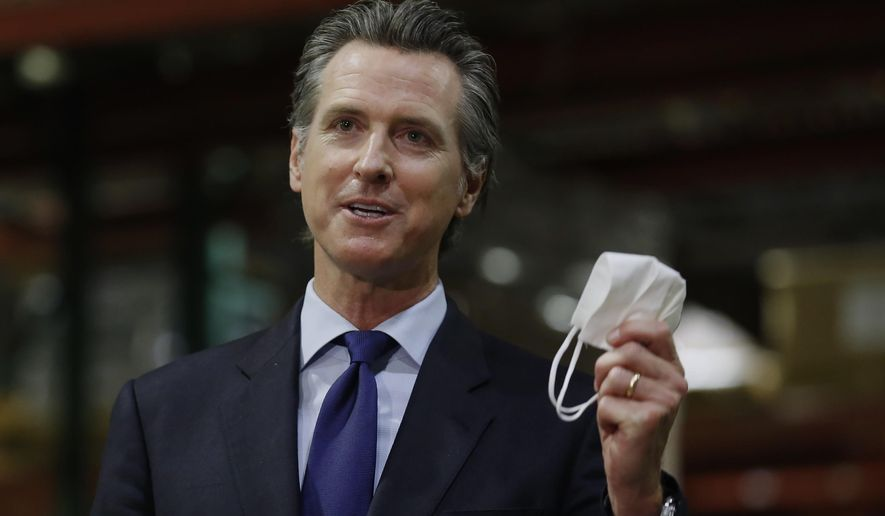 California Gov. Gavin Newsom displays a face mask as he urges people to wear them to fight the spread of the coronavirus during a news conference in Rancho Cordova, Calif., Friday, June 26, 2020. Gov. Newsom is cautiously optimistic that California is getting a grip on a resurgence of the coronavirus. But he warned Monday, Aug. 3, 2020, that the state is a long way from reopening some of the businesses it shuttered for a second time last month when new cases, hospitalizations, and deaths began surging. The seven-day average and rate of positive tests are both down, as are hospitalizations and intensive care cases. (AP Photo/Rich Pedroncelli, Pool, File)
