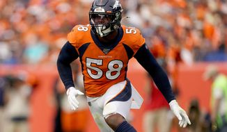 FILE - In this Sept. 15, 2019, file photo, Denver Broncos outside linebacker Von Miller (58) chases a play against the Chicago Bears during the second half of an NFL football game in Denver. Miller's body is buffer, his hair tinted orange on top.  The star linebacker says his dramatic offseason transfiguration was a result of his battle with the coronavirus, Kobe Bryant's untimely death and the Michael Jordan documentary. (AP Photo/Jack Dempsey, File)