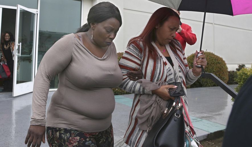 FILE - In this March 5, 2019, file photo, Sequette Clark, left, leaves the Calvary Christian Center after meeting with California Attorney General Xavier Becerra in Sacramento, Calif. California prosecutors on Tuesday, Aug. 4, 2020, asked the NFL to remove a video produced as part of the league's Inspire Change campaign, saying it misrepresents the circumstances leading to the fatal shooting of an unarmed Black man in 2018. The video shows Sequette Clark speaking about the death of her son, Stephon Clark, a vandalism suspect who was killed in the backyard of his grandparents' home after a chase by Sacramento police. (AP Photo/Rich Pedroncelli, File)