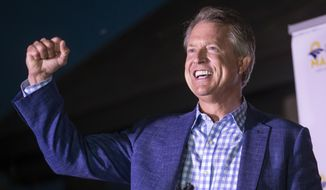 Roger Marshall pumps his fist after speaking to supporters near Pawnee Rock, Kan., Tuesday, Aug. 4, 2020, after defeating Kris Kobach in the Republican primary for U.S. Senate. (Travis Heying/The Wichita Eagle via AP)
