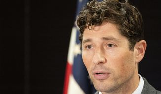 FILE - In this July 29, 2020 file photo, Minneapolis Mayor Jacob Frey speaks during a press conference in Minneapolis. In an interview with the Minneapolis Star Tribune Monday, Aug. 3, 2020, Frey said that Gov. Tim Walz hesitated to send in the National Guard to quell the growing violence after the death of George Floyd and then blamed him for allowing the city to burn. (Evan Frost/Minnesota Public Radio via AP File)