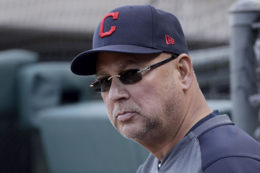 FILE - In this Feb. 23, 2020, file photo, Cleveland Indians manager Terry Francona watches during the fourth inning of a spring training baseball game against the Kansas City Royals in Surprise, Ariz. Francona continues to undergo medical tests for a gastrointestinal issue, and there remains no clear timetable for when he'll return to the team.  (AP Photo/Charlie Riedel, File)