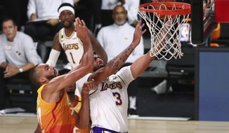 Los Angeles Lakers forward Anthony Davis (3) is fouled by Utah Jazz center Rudy Gobert, left, during the first half of an NBA basketball game Monday, Aug. 3, 2020, in Lake Buena Vista, Fla. (Kim Klement/Pool Photo via AP)
