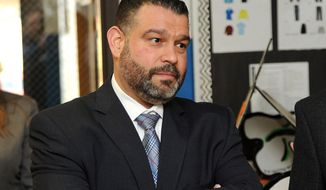 FILE - In this March 23, 2017 file photo, Pedro Rivera, secretary for the Pennsylvania Department of Education, tours Pfeiffer-Burleigh Elementary School in Erie, Pa. Rivera announced Tuesday, Aug. 4, 2020, he will be leaving the job to take another position, as schools throughout the state are scrambling to develop and implement pandemic reopening plans. (Christopher Millette/Erie Times-News via AP, File)