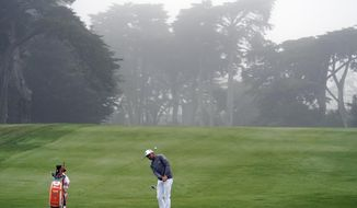 Rickie Fowler hits toward the 13th green during practice for the PGA Championship golf tournament at TPC Harding Park in San Francisco, Tuesday, Aug. 4, 2020. (AP Photo/Jeff Chiu)