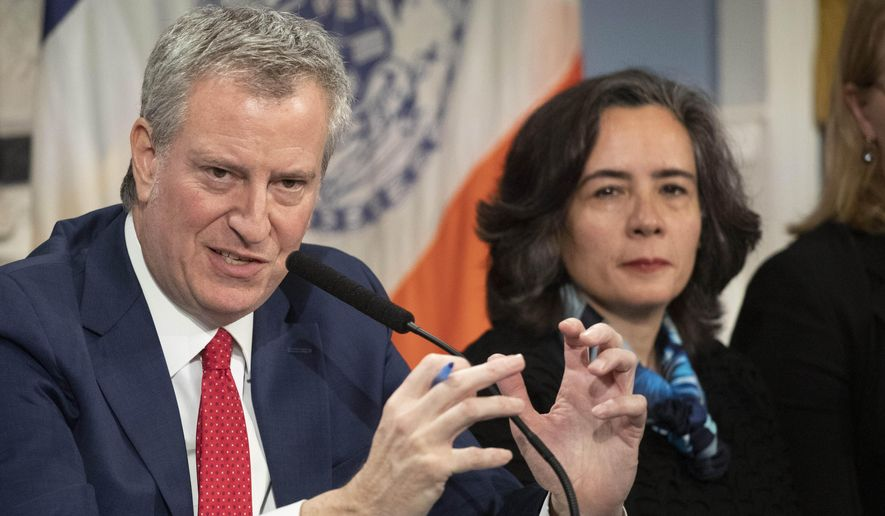 In this Wednesday, Feb. 26, 2020, file photo, Mayor Bill de Blasio, left, is shown with Dr. Oxiris Barbot, commissioner of the New York City Department of Health and Mental Hygiene, in New York. New York City abruptly replaced Barbot, its top public health official, Tuesday, Aug. 4, 2020, at a key point in its fight to keep the coronavirus from surging again. (AP Photo/Mark Lennihan, File)