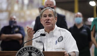Texas Gov. Greg Abbott speaks to the media during a visit to a Texas Division of Emergency Management Warehouse filled with Personal Protective Equipment, Tuesday, Aug. 4, 2020, in San Antonio. (AP Photo/Eric Gay) ** FILE **
