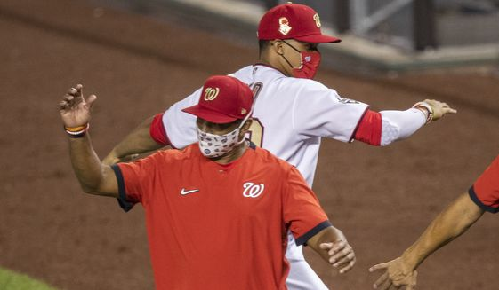Washington Nationals' Juan Soto, back, celebrates with manager Dave Martinez, after the Nationals defeated the New York Mets 5-3 a baseball game in Washington, Tuesday, Aug. 4, 2020. (AP Photo/Manuel Balce Ceneta) ** FILE **