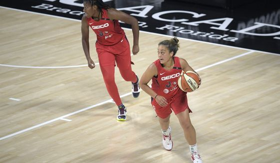 Washington Mystics guard Leilani Mitchell (5) brings the ball up the court in front of guard Ariel Atkins during the first half of a WNBA basketball game against the Indiana Fever, Saturday, July 25, 2020, in Bradenton, Fla. (AP Photo/Phelan M. Ebenhack)