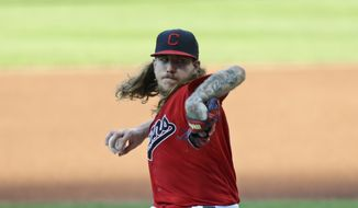 Cleveland Indians starting pitcher Mike Clevinger delivers in the first inning in a baseball game against the Cincinnati Reds, Wednesday, Aug. 5, 2020, in Cleveland. (AP Photo/Tony Dejak)  **FILE**