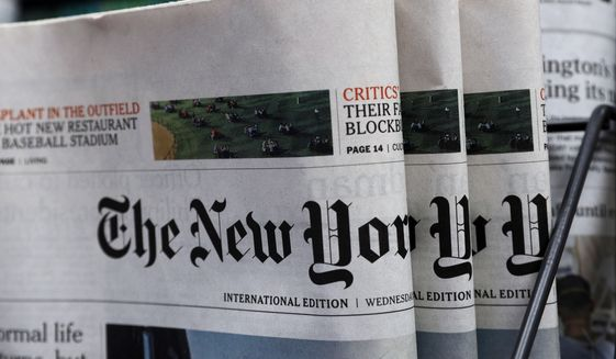 This July 15, 2020, file photo shows copies of The New York Times newspaper displayed for sale at a newsstand in Hong Kong. (AP Photo/Kin Cheung, File)