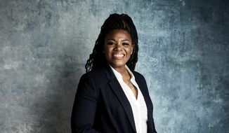 """In this Jan. 27, 2019, file photo Cori Bush poses for a portrait to promote the film """"Knock Down the House"""" at the Salesforce Music Lodge during the Sundance Film Festival in Park City, Utah. Bush, a onetime homeless woman who led protests following a White police officer's fatal shooting of a Black 18-year-old in Ferguson, Mo., ousted longtime Rep. William Lacy Clay Tuesday in Missouri's Democratic primary, ending a political dynasty that has spanned more than a half-century. (Photo by Taylor Jewell/Invision/AP, File)"""