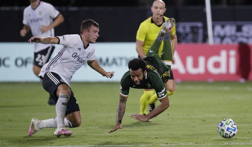 Philadelphia Union defender Kai Wagner, left, and Portland Timbers midfielder Eryk Williamson collide during the first half of an MLS soccer match, Wednesday, Aug. 5, 2020, in Kissimmee, Fla. (AP Photo/John Raoux)