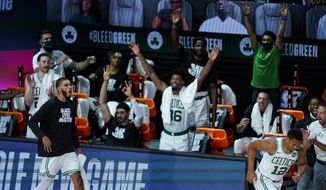 The Boston Celtics bench celebrates during the second half of an NBA basketball game against the Brooklyn Nets Wednesday, Aug. 5, 2020 in Lake Buena Vista, Fla. (AP Photo/Ashley Landis)