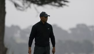 Tiger Woods walks on the 16th hold during a practice round for the PGA Championship golf tournament at TPC Harding Park Wednesday, Aug. 5, 2020, in San Francisco.(AP Photo/Charlie Riedel)