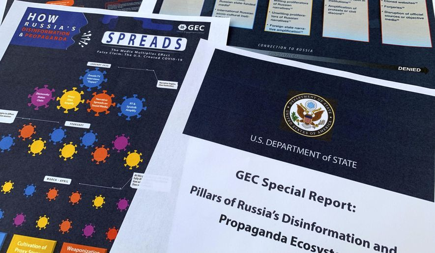 Pages from the U.S. State Department's Global Engagement Center report released on Aug. 5, 2020, are seen in this photo. The State Department says Russia is using a well-developed online operation that includes a loose collection of proxy websites to stir up confusion around the coronavirus by amplifying conspiracy theories and misinformation. The department detailed a Russian-backed misinformation cycle that spreads false information online through state officials and state-funded media reports, by infiltrating U.S. social media conversation, and leveraging a deceptive internet framework of websites. (AP Photo/Jon Elswick) **FILE**