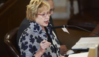 Nebraska Sen. Lou Ann Linehan of Elkhorn speaks in Lincoln, Neb., Wednesday, Aug. 5, 2020, as lawmakers debate a property tax and business incentive package. (AP Photo/Nati Harnik)