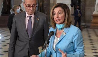 House Speaker Nancy Pelosi of Calif., joined by Senate Minority Leader Sen. Chuck Schumer of N.Y., speaks to media on Capitol Hill in Washington, Wednesday, Aug. 5, 2020. Some clarity is beginning to emerge from the bipartisan Washington talks on a huge COVID-19 response bill. An exchange of offers and meeting devoted to the Postal Service on Wednesday indicates the White House is moving slightly in House Speaker Nancy Pelosi's direction on issues like aid to states and local governments and unemployment insurance benefits. But the negotiations have a long ways to go. (AP Photo/Carolyn Kaster)