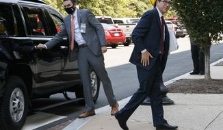 Treasury Secretary Steven Mnuchin arrives for continued negotiations ahead of a meeting, Wednesday, Aug. 5, 2020, on Capitol Hill in Washington. (AP Photo/Jacquelyn Martin)