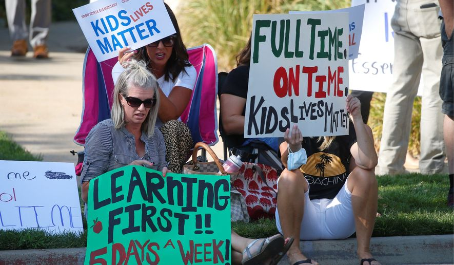 A group of parents protested a hybrid reopening plan this week in Farmington, Utah. They said the district should open schools to their children five days a week. Many parents worry about keeping their children home any longer as the COVID-19 risks change. (Associated Press)
