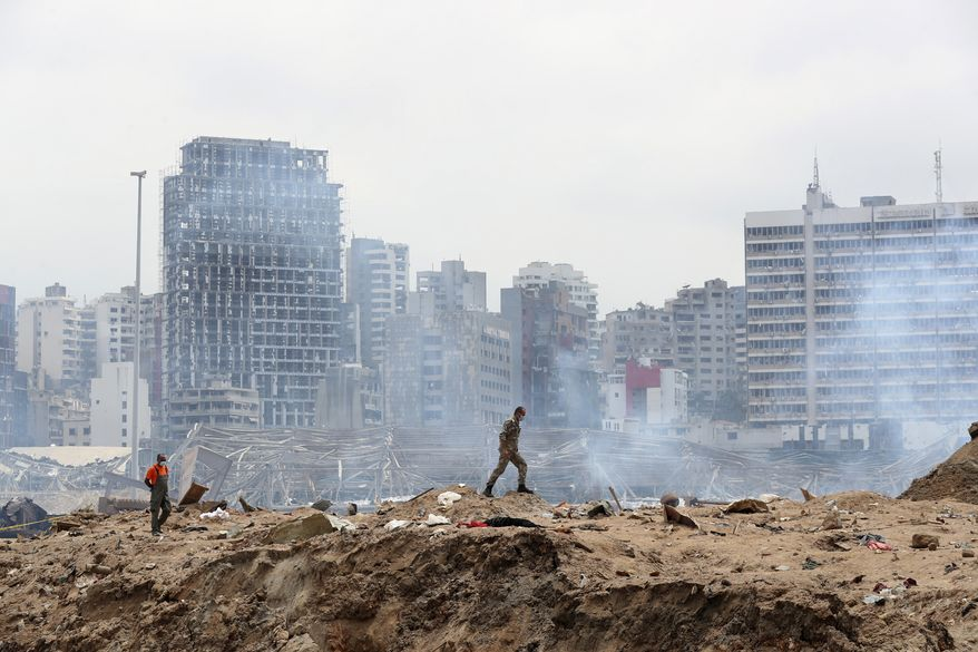 A soldier walks at the devastated site of the explosion in the port of Beirut, Lebanon, Thursday Aug.6, 2020. French President Emmanuel Macron came in Beirut to offer French support to Lebanon after the deadly port blast.(AP Photo/Thibault Camus, Pool)