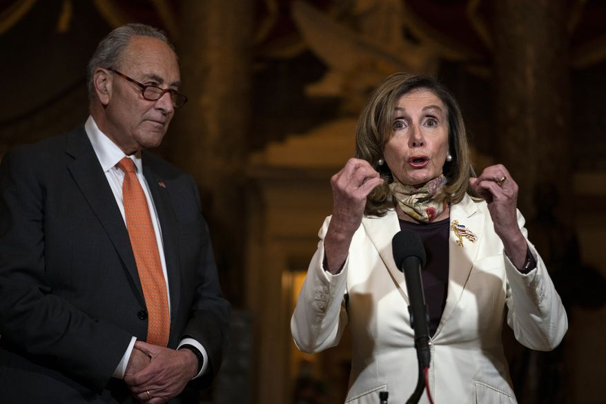House Speaker Nancy Pelosi of Calif., joined by Senate Minority Leader Sen. Chuck Schumer of N.Y., speaks to reporters on Capitol Hill in Washington, Thursday, Aug. 6, 2020. (AP Photo/Carolyn Kaster)