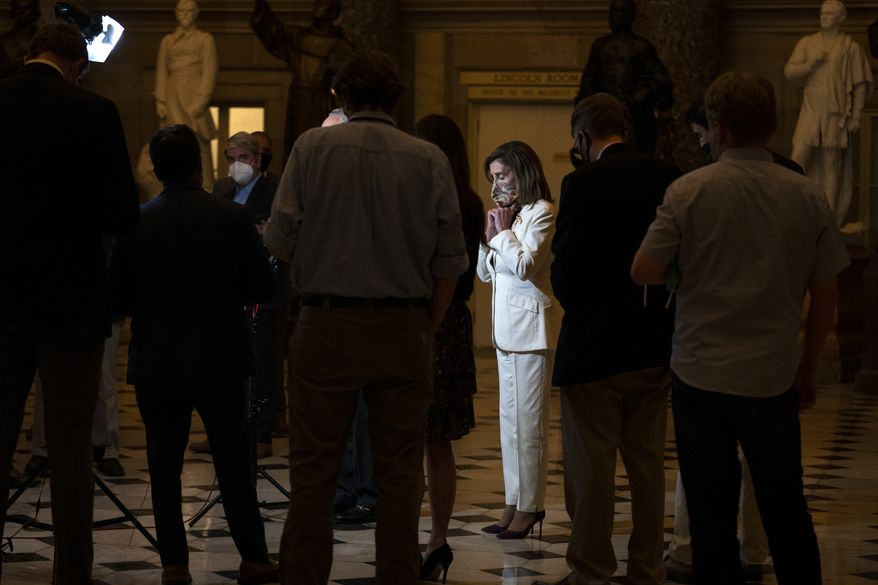 House Speaker Nancy Pelosi of Calif., pauses as she speaks to reporters on Capitol Hill in Washington, Thursday, Aug. 6, 2020. (AP Photo/Carolyn Kaster)