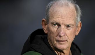 In this July 18, 2020, photo, National Rugby League Rabbitohs coach Wayne Bennett watches his players during a match in Sydney, Australia. Bennett could face a stint in 14-day quarantine after admitting he ate at a Sydney restaurant on Wednesday, Aug. 5, 2020, in a breach of the NRL's COVID-19 quarantine restrictions. (Joel Carrett/AAP Image via AP)