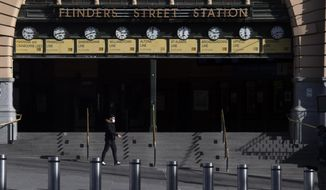 Flinders Street Station is quiet during lockdown due to the continuing spread of the coronavirus in Melbourne, Thursday, Aug. 6, 2020. Victoria state, Australia's coronavirus hot spot, announced on Monday that businesses will be closed and scaled down in a bid to curb the spread of the virus. (AP Photo/Andy Brownbill)