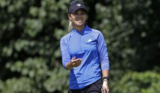 Danielle Kang gestures as she leaves her birdie putt on the sixth green short during the first round of the Marathon Classic LPGA golf tournament Thursday, Aug. 6, 2020, at the Highland Meadows Golf Club in Sylvania, Ohio. Kang finished her round tied for the early lead at 7-under par. (AP Photo/Gene J. Puskar)