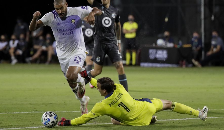 Minnesota United goalkeeper Tyler Miller blocks a shot by Orlando City forward Tesho Akindele during the first half of an MLS soccer match, Thursday, Aug. 6, 2020, in Kissimmee, Fla. (AP Photo/John Raoux)