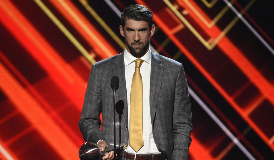 "Michael Phelps accepts the award for best record-breaking performance at the ESPYS on July 12, 2017, in Los Angeles. Olympians including Phelps, Apolo Ohno and Jeremy Bloom are opening up about their mental health struggles in a new sobering documentary about suicide and depression among the world's greatest athletes. Many of the athletes are sharing their pain for the first time in HBO's ""The Weight of Gold,"" which aims to expose the problem, incite change among Olympics leadership and help others experiencing similar issues feel less alone. (Photo by Chris Pizzello/Invision/AP, File)  **FILE**"