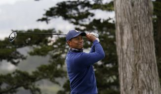 Tiger Woods watches his tee shot on the 14th hole during the first round of the PGA Championship golf tournament at TPC Harding Park Thursday, Aug. 6, 2020, in San Francisco. (AP Photo/Jeff Chiu)