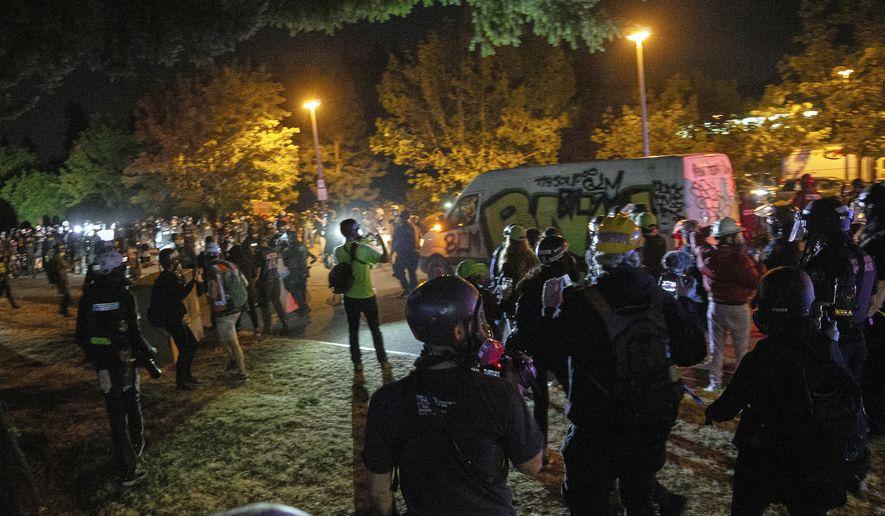 Demonstrators gather at Floyd Light City Park Thursday, Aug. 6, 2020, in Portland, Ore. (Mark Graves/The Oregonian via AP)