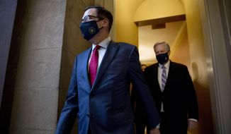 Treasury Secretary Steven Mnuchin, left, and White House Chief of Staff Mark Meadows, right, walk to speak to reporters after meeting with House Speaker Nancy Pelosi of Calif. and Senate Minority Leader Sen. Chuck Schumer of N.Y. as they continue to negotiate a coronavirus relief package on Capitol Hill in Washington, Friday, Aug. 7, 2020. (AP Photo/Andrew Harnik)